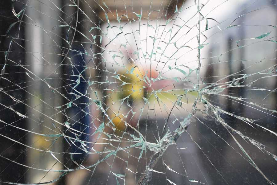 close up of the broken glass of a window
